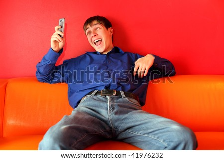 teenager get funny sms on the phone - stock photo