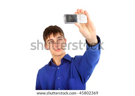 teenager gets ready to take a photograph with mobile phone - stock photo