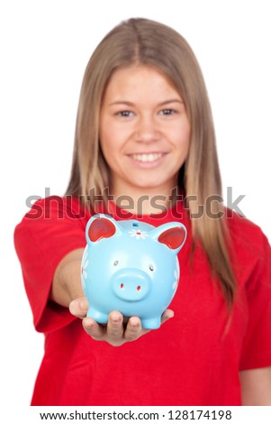 Teenager girl and a moneybox isolated on white background with focus on the piggy-bank