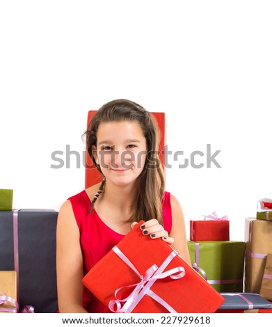 Teenager girl around several presents