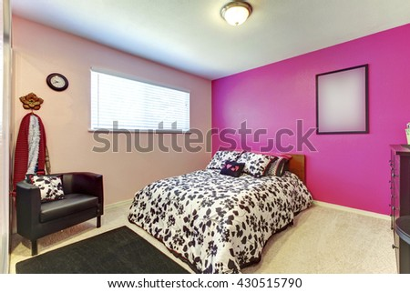 Teenager girl bedroom with bright pink wall and simple interior. - stock photo
