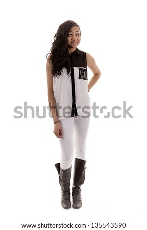 teenager girl dressed in white clothes with one hand on hip - stock photo