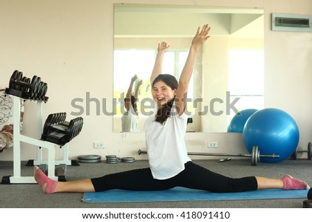 teenager girl has lesson yoga class on mat stretching split exercise