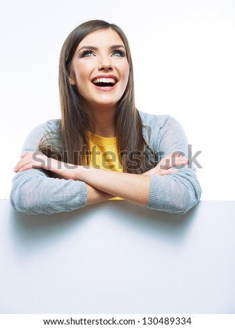 Teenager girl hold white blank paper. Young smiling woman yellow dressed show blank card. Girl portrait isolated on white background. - stock photo