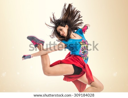 Teenager girl jumping in street dance style - stock photo