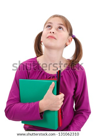 Teenager girl looking up, holding maps and pencils in her hand - stock photo