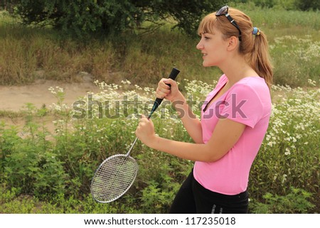 Teenager girl playing tennis on the nature - stock photo