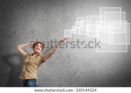 Teenager girl reaching media icon with hand - stock photo