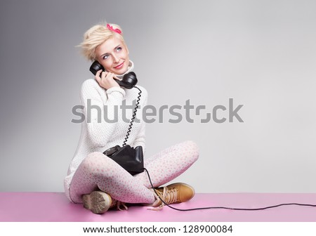 teenager girl speeaking with her boyfriend on the phone and smiling - stock photo