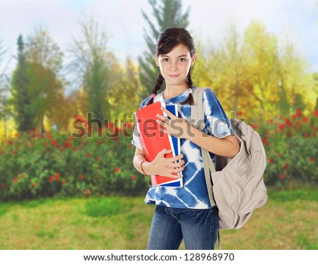 Teenager girl whit braids going to school - stock photo