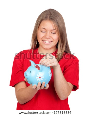 Teenager girl with a moneybox isolated on white background