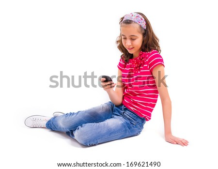Teenager Girl with cell phone on white background