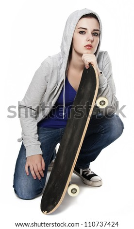 teenager girl with skateboard white background - stock photo