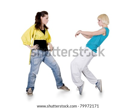 Teenager girls dancing hip-hop over white background - stock photo