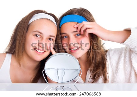 Teenager girls showing the blemishes on theirs skin - stock photo