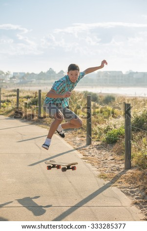teenager have fun and high jumping with skateboard