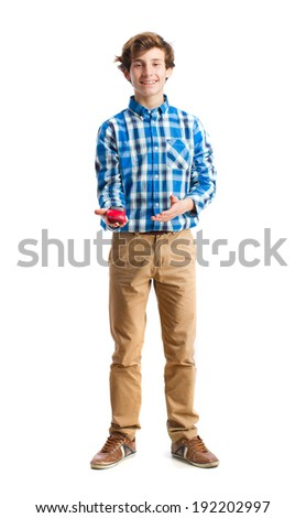 teenager holding a car toy