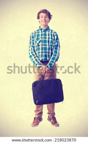 teenager holding a suitcase - stock photo