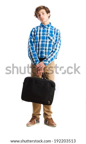 teenager holding a suitecase