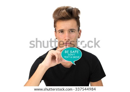"Teenager holding thought bubble ""Be Safe Don't Text & Drive"" - stock photo"