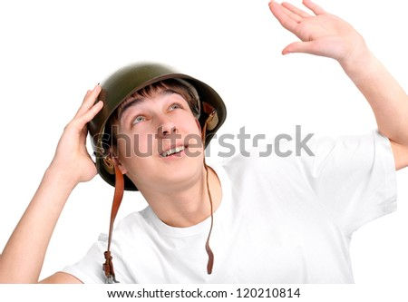 teenager in a military helmet isolated on the white background - stock photo
