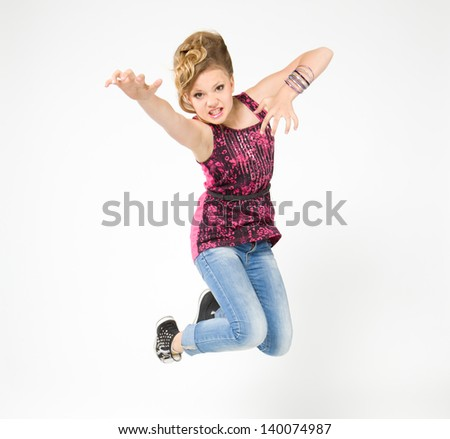 Teenager in bounce, dressed in rock style on the white background