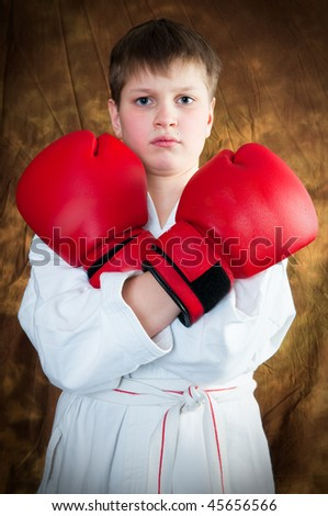 teenager in boxing gloves