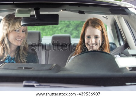 Teenager in car with driving instructor