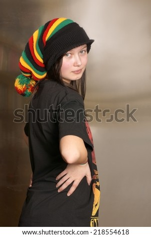 Teenager in Rasta cap on his head - stock photo