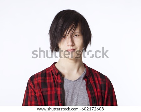 Teenager in red shirt smiling portrait
