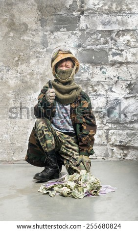 Teenager in uniform of soldier with money