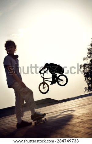 teenager jump on a bicycle outdoors