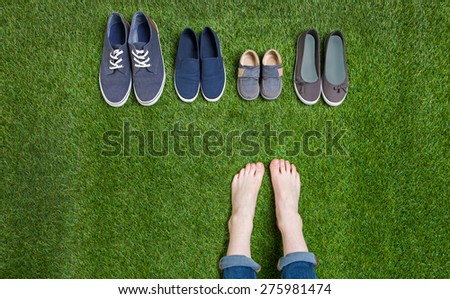 Teenager legs and shoes standing  on grass