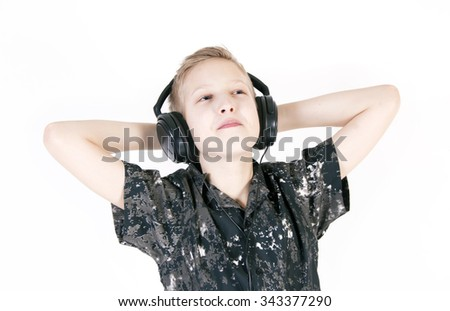 Teenager listening music with headphones, isolated on white background.