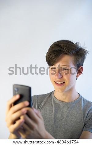 Teenager  looking at his smart phone.