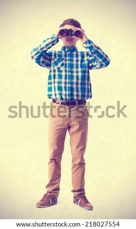 teenager looking for a binoculars - stock photo