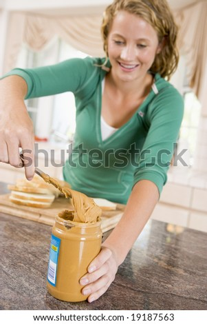 Teenager Making A Peanut Butter Sandwich