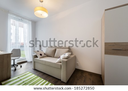 Teenager modern room with green carpet on the floor - stock photo