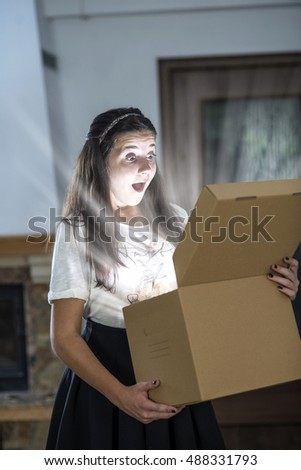 Teenager opening a parcel