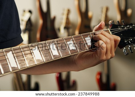 Teenager Playing Electric Guitar - stock photo