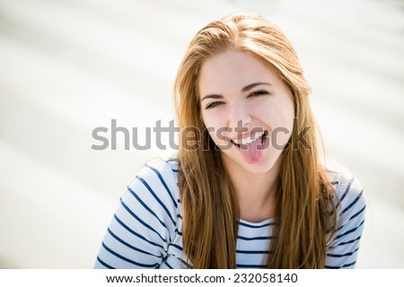 Teenager portrait - smiling girl outdoor on sunny day - stock photo