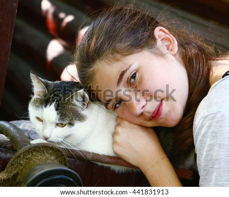 teenager pretty girl with cat close up portrait