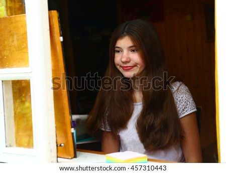 teenager pretty girl with long dark hair close up portrait look in the mirror make morning make up