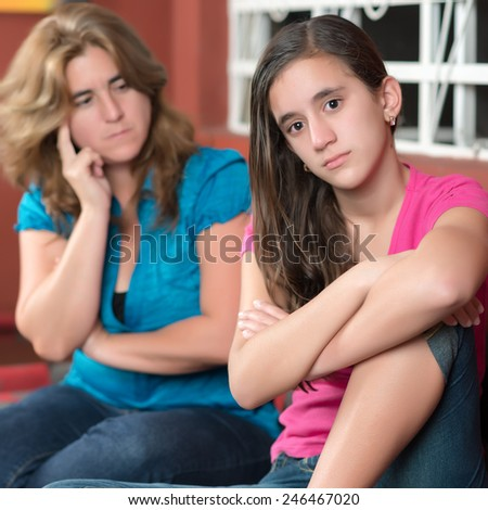 Teenager problems - Teenage girl ignoring her worried mother - stock photo