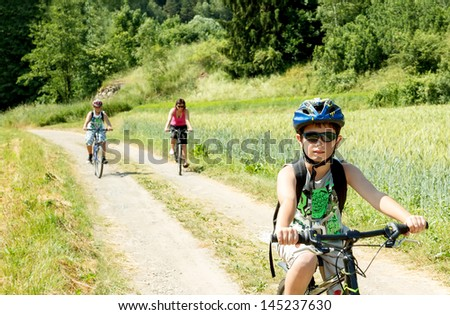 Teenager riding bicycle on trip in sunny day