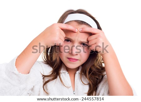 Teenager's skin problem concept: girl squeezing her pimple - stock photo
