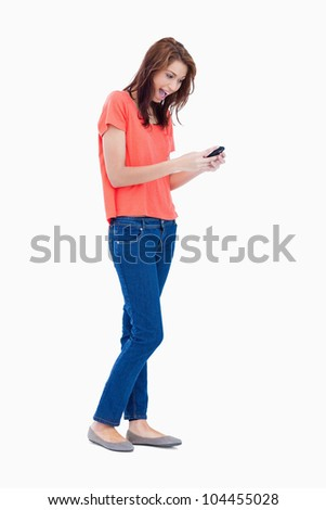 Teenager showing her surprise after receiving a text - stock photo
