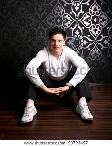 Teenager sitting on the floor - stock photo
