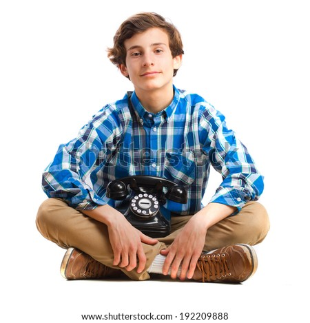teenager sitting with a telephone - stock photo
