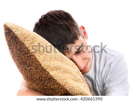 Teenager sleeps with Cushion Isolated On The White Background - stock photo